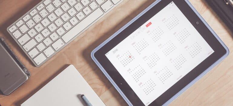 Tablet open to a calendar.