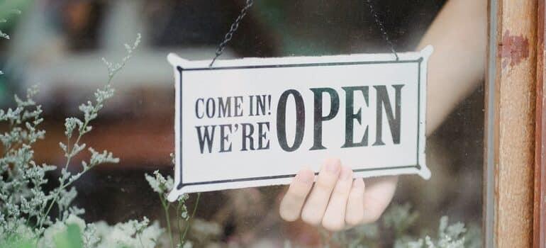 """""""open"""" sign on a door."""