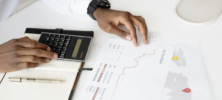Person calulating a budget for a business.