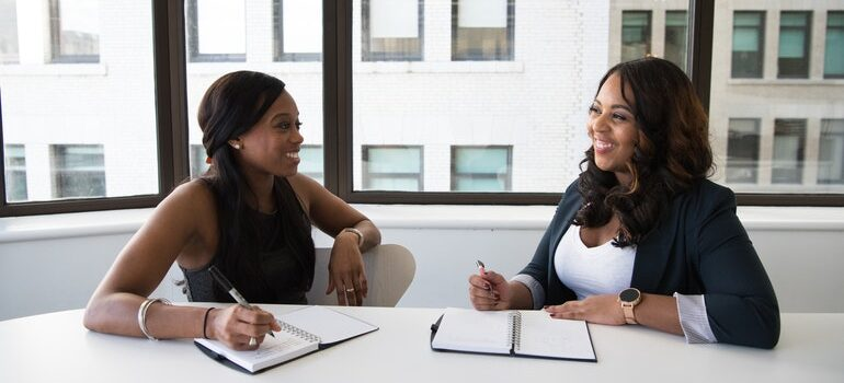 Woman asking Important questions to ask your SEO specialist at a job interview.