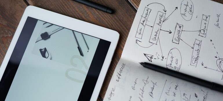 A plan for nurturing long-term relationships with customers on a tablet and notebook.