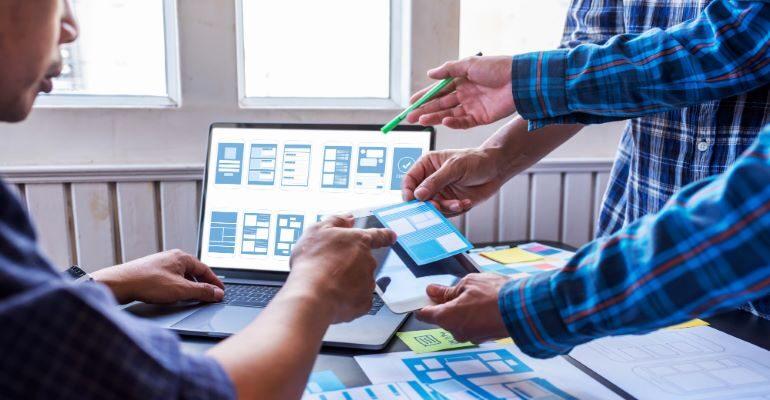 Team of designers discussing app design.
