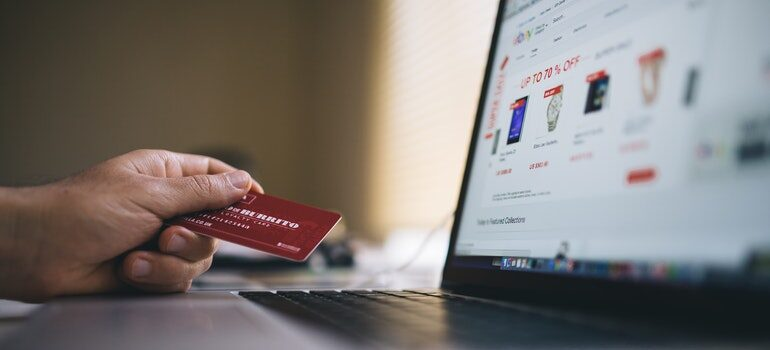 Person making a purchase online after being converted by conscious marketing.