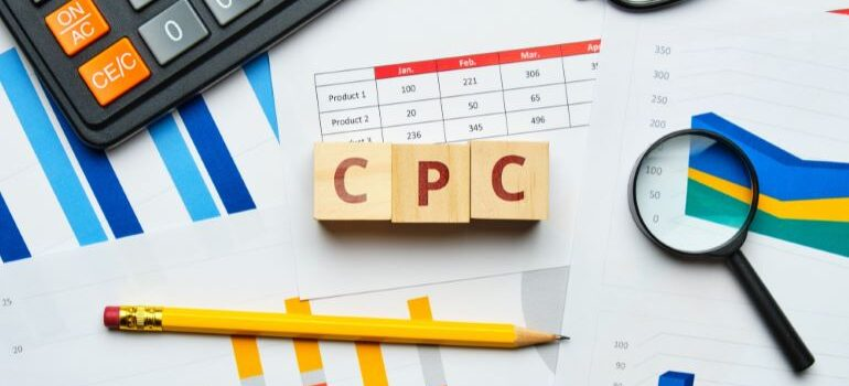 Three wooden dice that spell CPC.