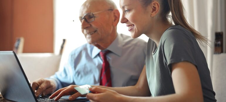 Young woman and an old man trying to create a customer-centric strategy
