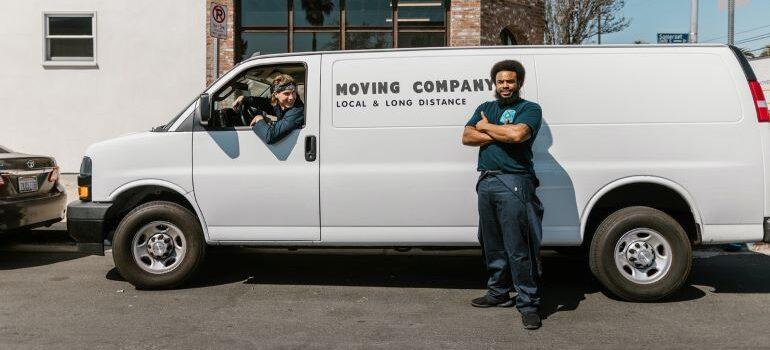 A two-man moving crew with a van.