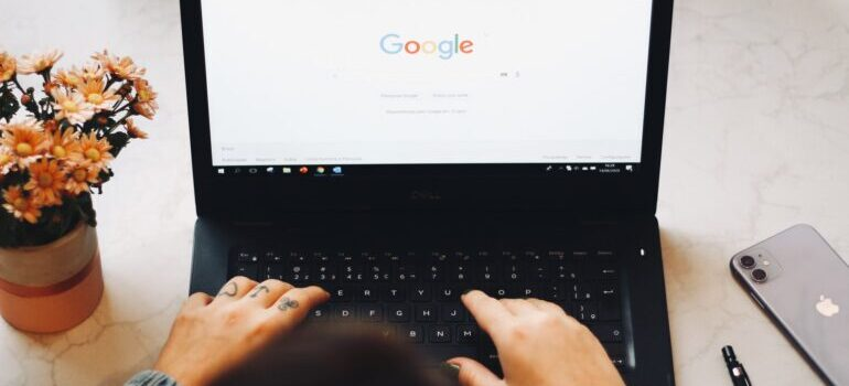 person making a google search on components of a quality moving company webpage