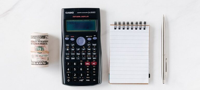 Cash, calculator, and notepad.
