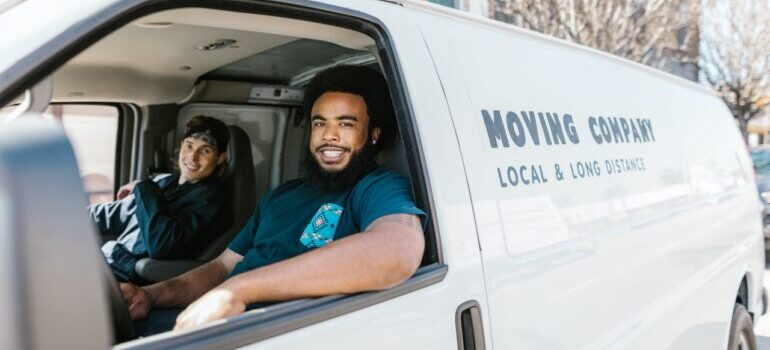 two movers in a moving van